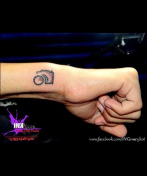 Minimalist Tattoo, Camera Tattoo, Wrist tattoo, Inkism tattoo and body piercing rajkot gujarat